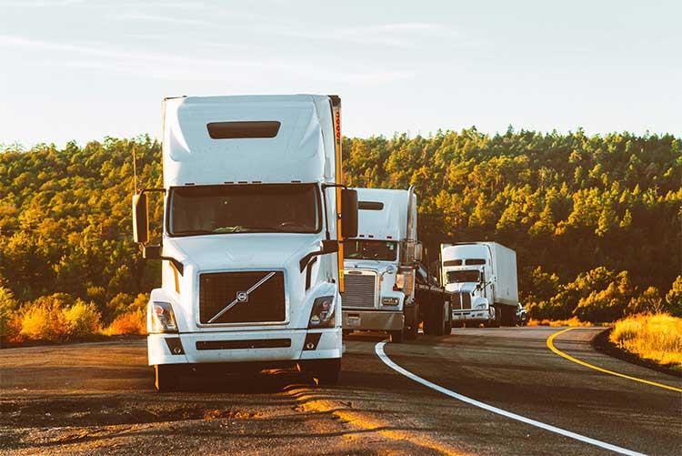 Trucks on a road delivering goods.